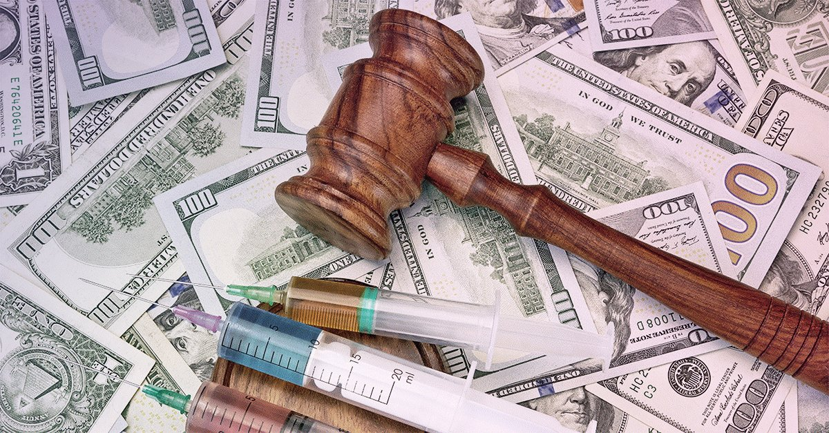 Image of gavel and syringes over paper money